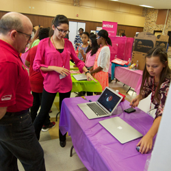 Students showcase their technology skills during community event for STEM.
